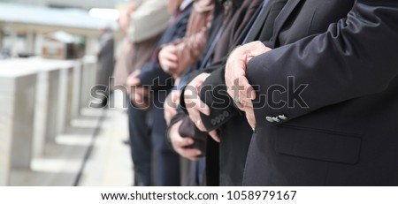 Muslim People in a Row at a Funeral in Mid Day