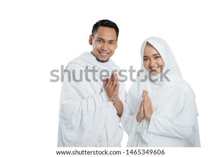 muslim pilgrims wife and husband wearing white traditional clothes for Ihram ready for Hajj
