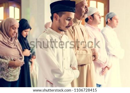 Muslim prayers in Qiyaam posture #1106728415