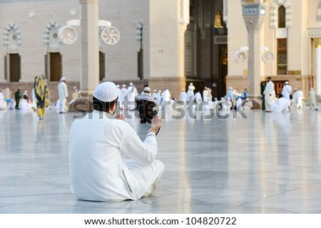 Muslim praying at Medina holy Islamic city