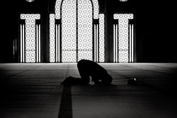 Muslim praying in a mosque