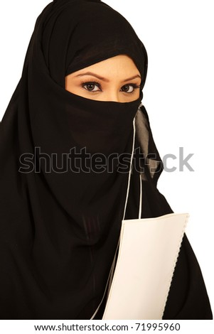 Muslim teenage girl holding books in her hand.