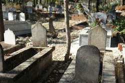 Muslim tombstones in graveyard. Graves with headstones at Muslim cemetery in summer season.