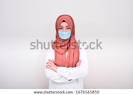Muslim woman doctor wearing medical mask, muslim girl wearing mask for viral infection