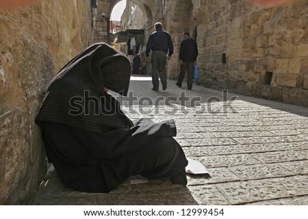Muslim woman in paranja on Jerusalem street
