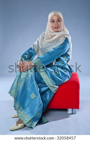Muslim woman in traditional Islamic clothing made out of full suit