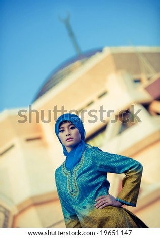 muslim woman posing in front mosque
