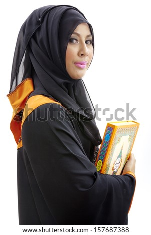 Muslim woman reading holy koran