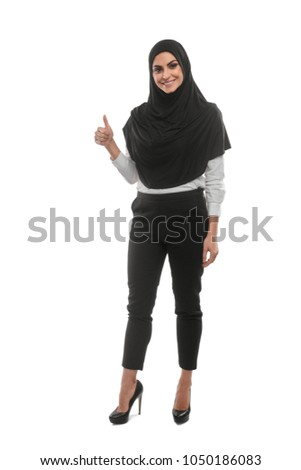 Muslim woman showing thumb up. Business worker's friendly gestures and attitude. Isolated on white.