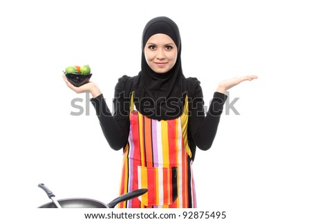 Muslim woman smiling happy presenting with open hand palm on white