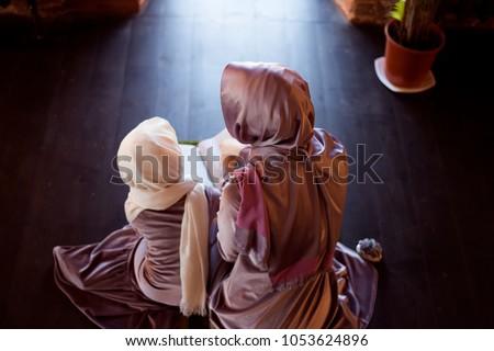 Muslim woman teaches children to read the Quran