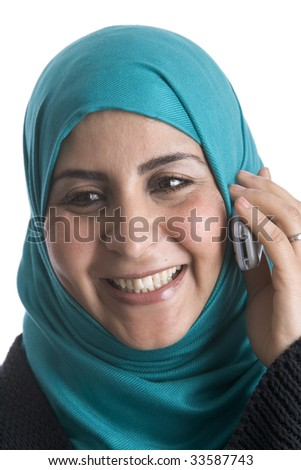 Muslim woman with a mobile phone - stock photo