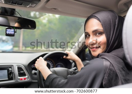 Muslim women driving car.