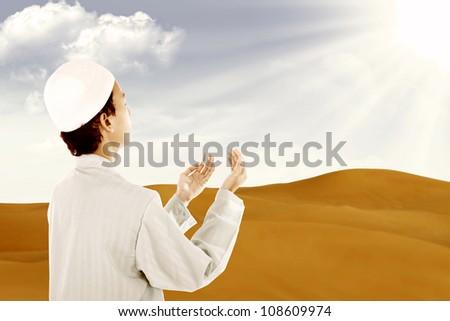 Muslim worshiping Allah in a desert during the month of Ramadan