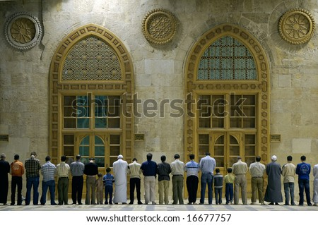 Muslims say prayers in old mosque in Damascus, Syria, first position #1
