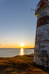 Musquash Head Lighthouse sunset in November 2019. New Brunswick Canada - Saint John region. Wide angle