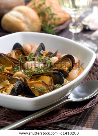 mussel soup with bean and thyme on bowl