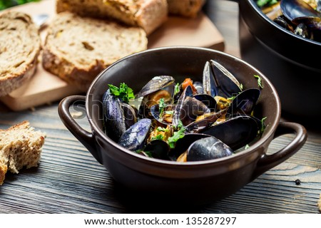 Mussels and fresh vegetables served at home