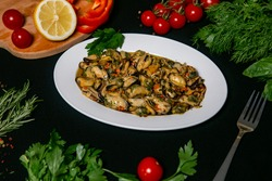 mussels in oil with spices. mussels in oil and spices (appetizer mollusks, pickled seafood, healthy food) menu concept. food background. Delicious seafood mussels with lemon and parsley.
