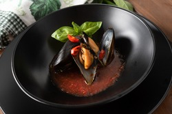Mussels Marinara, plate of delicious mussels with spicy tomato sauce