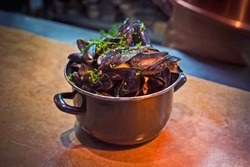 mussels pot full of mussels with hand cut fries