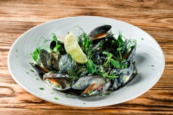 Mussels with pepper and lemon, plate of mussels. Traditional French Corsican mussel stew with mussels