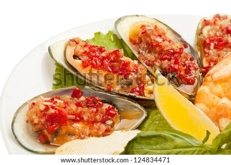 mussels with vegetables on a white background