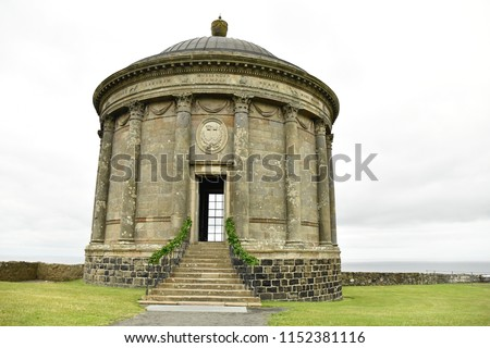 Mussenden temple at downhill beach Northern Ireland on a wet, overcast day.