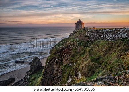 Mussenden Temple is a small circular building located on cliffs near Castlerock in County Londonderry, high above the Atlantic Ocean on the north-western coast of Northern Ireland