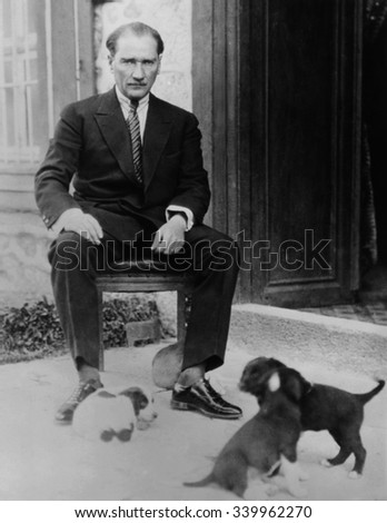 Mustafa Kemal Ataturk, President of Turkey, with his pet dogs, ca. 1930. As part of Kemal\'s modernization and Westernization of Turkey, he encouraged the acceptance of dogs, and the end to their relig