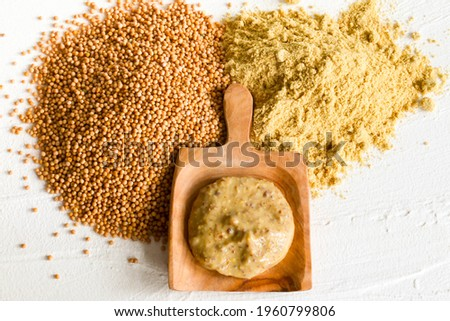 Mustard. Different types of mustard, dry fuel sauce and mustard powder Foto stock ©