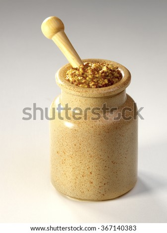 mustard in a rustic potty with...