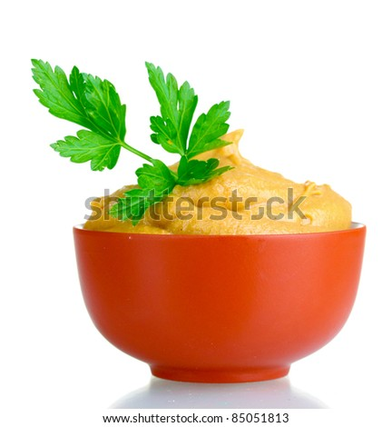 Mustard in bowl and parsley isolated on white