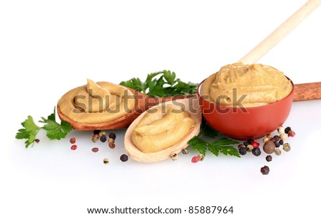 Mustard in bowl and spoons, spices and parsley isolated on white
