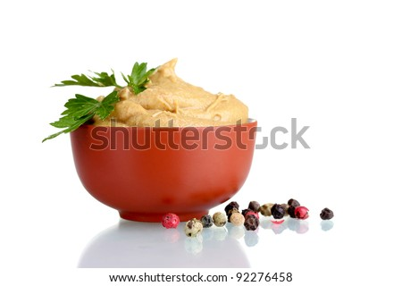Mustard in bowl, spices and parsley isolated on white