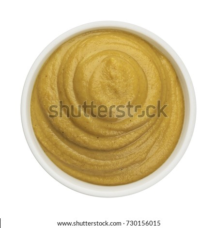 Mustard isolated on white background. Top view #730156015