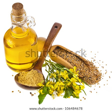 Mustard oil  jar and mustard powder spoon, seeds scoop, with fresh mustard flower on white