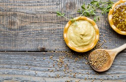Mustard on wood with mustard seeds