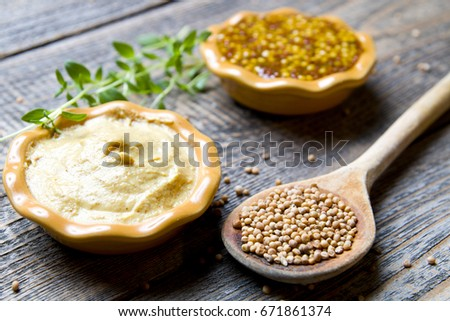 Mustard on wood with mustard seeds #671861374