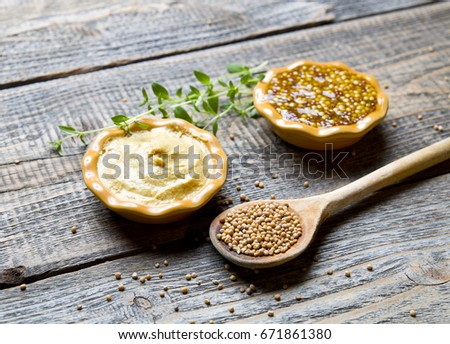 Mustard on wood with mustard seeds #671861380