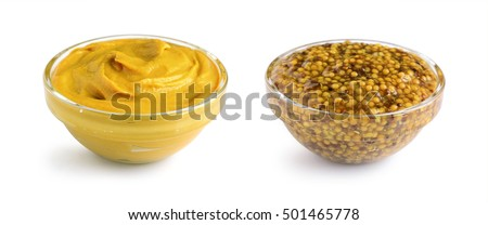 Mustard sauce and wholegrain mustard in two glass bowls isolated on white #501465778