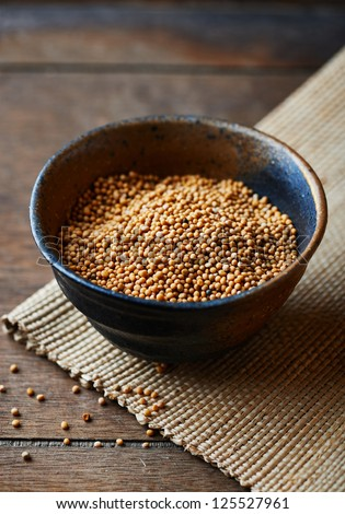 Mustard seeds in a ceramic dish