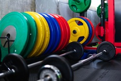 Muticolor weight plate inthe functional training gym before start the class.