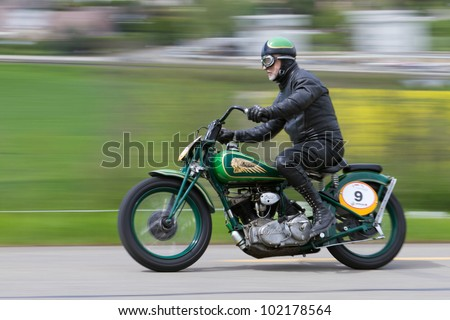 MUTSCHELLEN, SWITZERLAND-APRIL 29: Vintage motorbike Indian Sport Scout from 1938 on display at Grand Prix in Mutschellen, SUI on April 29, 2012.  Invited were vintage sports cars and motorbikes. - stock photo