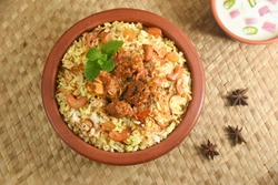 Mutton biryani , Gosht or lamb biryani or Hyderabadi Dum biriyani with raita yoghurt dip special occasion festival food for Ramadan , Eid Hyderabad India.
