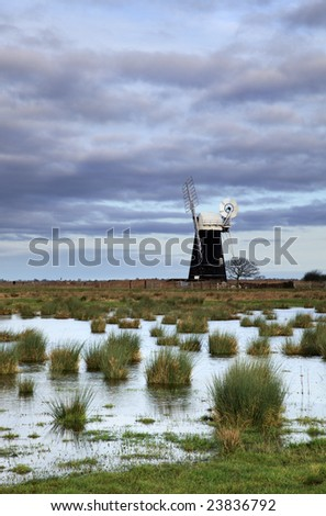 Muttons Drainage Mill across the water logged ground of Halvergate Marshes.