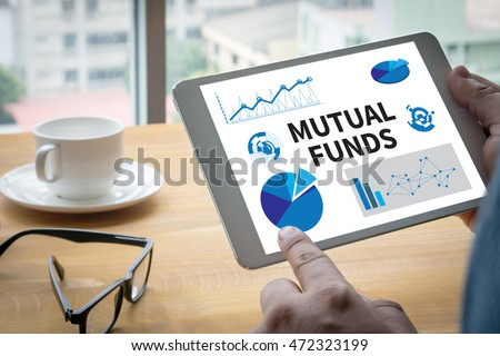 MUTUAL FUNDS Computing Computer  Laptop with screen on table Silhouette and filter sun