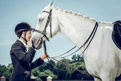 My best friend. Nice beautiful woman smiling while standing in front of her horse