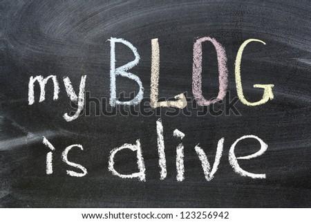 my blog is alive phrase handwritten on school blackboard