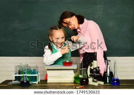 My chemistry experiment. School chemistry lessons. Chemistry science. Child from elementary school. Education. Biology experiments with microscope. Chemistry lesson